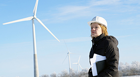 Worker in front of windmills